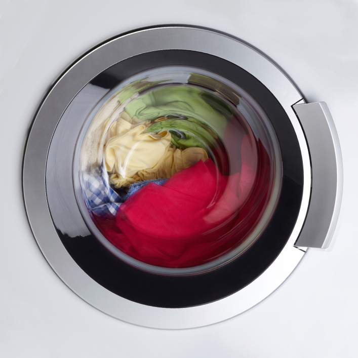 Clothes sitting in a closed washing machine