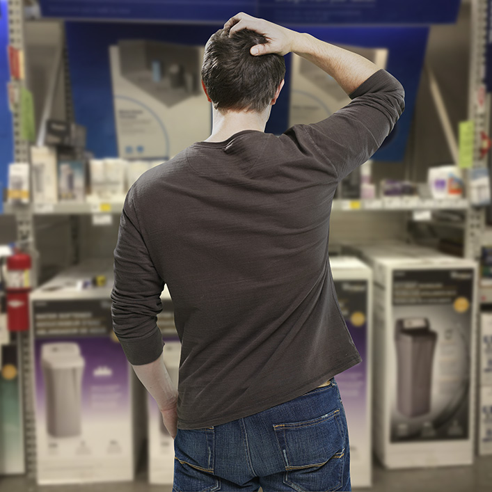 man in store diy holiday confused