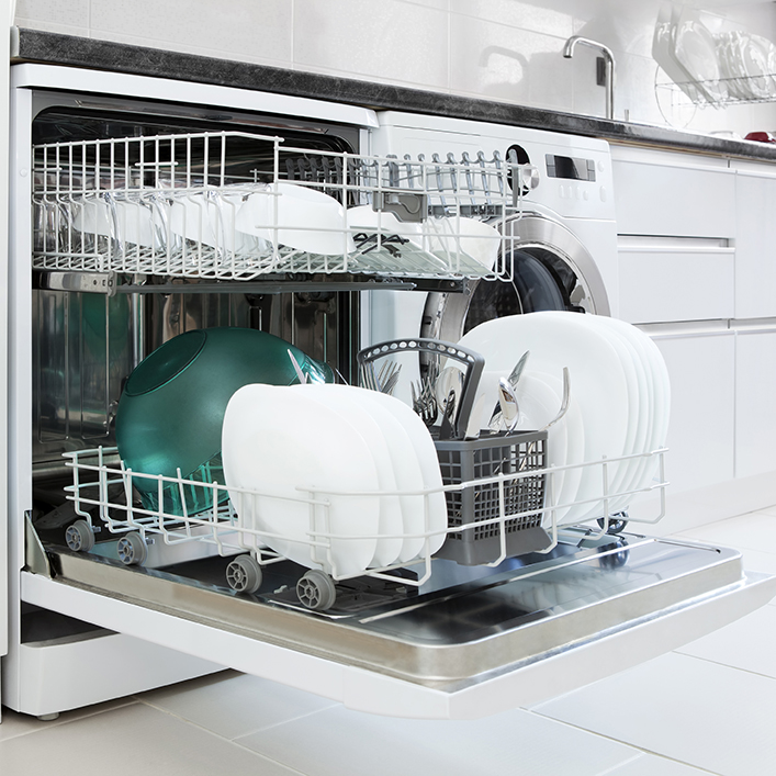 Clean dishes sitting in a dishwasher with the door open and the racks out